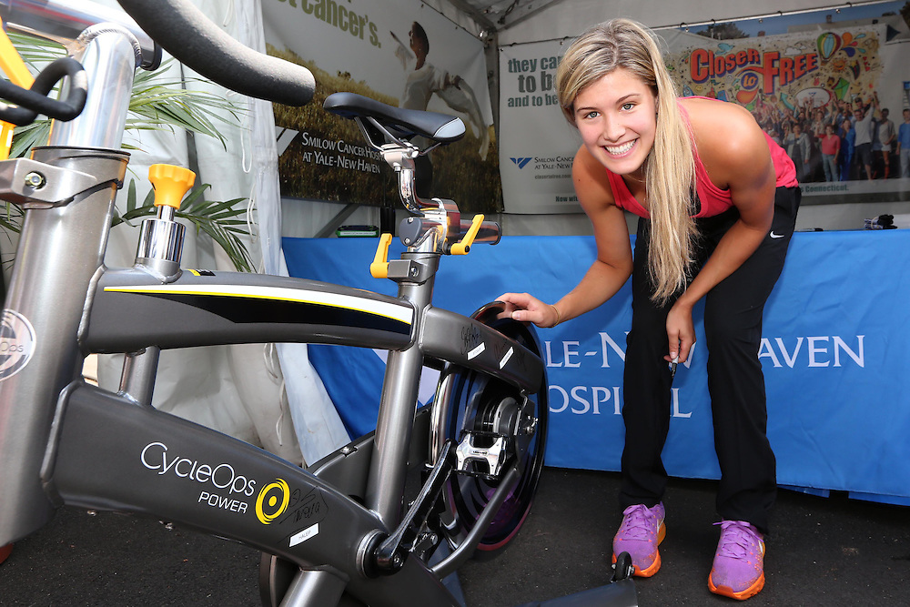 August 16, 2014, New Haven, CT:<br /> Eugenie Bouchard autographs a spin bike in the Yale New Haven Health booth during WTA All-Access Hour on day three of the 2014 Connecticut Open at the Yale University Tennis Center in New Haven, Connecticut Sunday, August 17, 2014.<br /> (Photo by Billie Weiss/Connecticut Open)