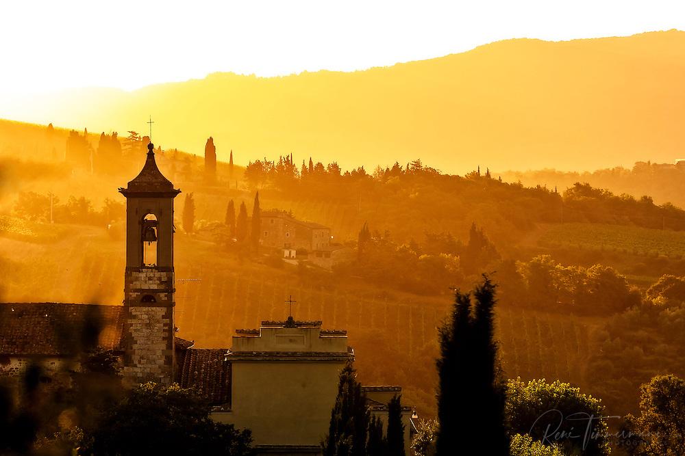 Tuscan church in an early morning golden sunrise