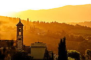 Tuscan church in an early morning golden sunrise