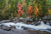 The rapids of Little Niagara falls, although small are extremely picturesque in the fall,  Baxter State Park, Maine, USA