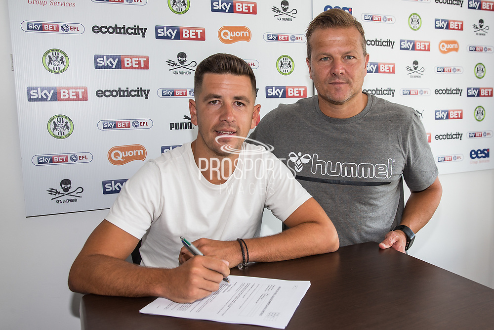Lloyd James signing for Forest Green Rovers with Forest Green Rovers manager, Mark Cooper at the New Lawn, Forest Green, United Kingdom on 4 July 2018. Picture by Shane Healey