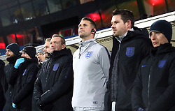England U21 manager Aidy Boothroyd (centre left) and backroom staff during the international friendly match at the Blue Water Arena, Esbjerg.