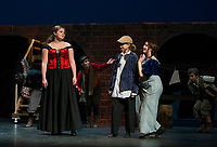 "Cecilia Zarella as Nancy, Kathryn Osburn as Oliver and Chelsea Sasserson at Bet during dress rehearsal for Gilford High School's musical ""Oliver"" on Tuesday evening.   (Karen Bobotas/for the Laconia Daily Sun)"