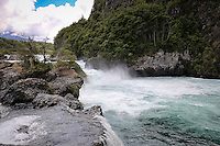 The emerald waters rushing down the Petrohue River explode over the rocky slopes in the Vicente Perez Rosales National Park in Chile, near Puerto Montt.