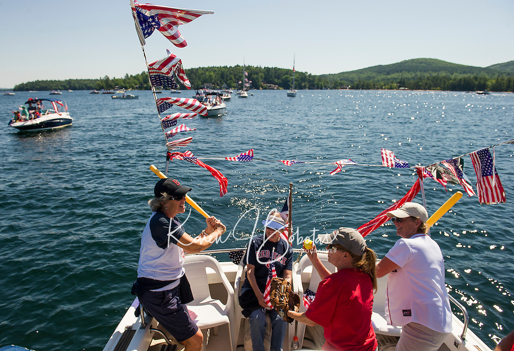 Ruth McLaughlin, Sharon Nix and Maureen Nix get warmed up with Red Sox fever on board the SS Minnow during the Winnipeaukee Yacht Club's 4th of July boat parade leaving Saunders Bay on Monday morning.  (Karen Bobotas/for the Laconia Daily Sun)