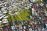 A junkyard contains cars and boats (seen in detail) damaged by Hurricane Katrina.