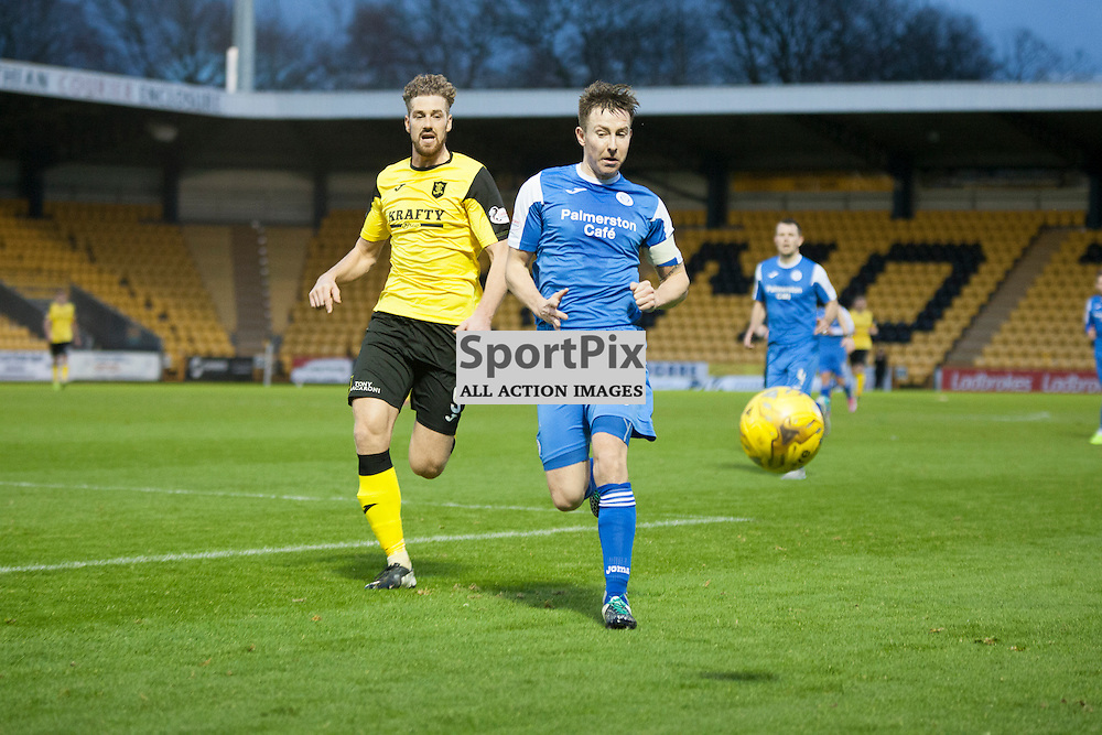 Livingston v Queen of the South, Scottish Championship, 2 January 2016, Chris Higgins (Queen of the South, 6) shields the ball from Jordan White (Livingston, 9) during the Livingston v Queen of the South Scottish Championship match played at the Toni Macaroni Arena, © Chris Johnston | SportPix.org.uk