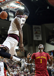 Texas A&M's Danuel House (23) dunks as Iowa State's Jameel McKay (1) reacts during the first half of an NCAA college basketball game, Saturday, Jan. 30, 2016, in College Station, Texas. Texas A&M won 72-62. (AP Photo/Sam Craft)