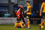 York City forward, on loan from Burnley, Ntumba Mabssanka  attempts to help \Newport County midfielder, on loan from Crystal Palace, Connor Dymond  to his feet  during the Sky Bet League 2 match between York City and Newport County at Bootham Crescent, York, England on 16 January 2016. Photo by Simon Davies.
