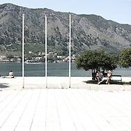 An old monument in Kotor.There are several arguments about the derivation of the name  &quot;Montenegro&quot;, one of these relates to dark and deep forests  that once covered the Dinaric Alps, as it was possible to see them from the sea. <br /> Mostly mountainous with 672180 habitants on an area of 13812 Km&sup2;, with a population density of  48 habitants/Km&sup2;. <br /> It borders with Bosnia, Serbia, Croatia, Kosovo and Albania but  Montenegro has always been alien to the bloody political events that characterized Eastern Europe in recent decades. <br /> From 3 June 2006, breaking away from Serbia, Montenegro became an independent state. <br /> In the balance between economy devoted to sheep farming and a shy tourist, mostly coming from Bosnia and Herzegovina, Montenegro looks to Europe with a largely unspoiled natural beauty. <br /> Several cities in Montenegro, as well as the park Durmitor, considered World Heritage by UNESCO but not yet officially because Montenegro has yet to ratify the World Heritage Convention of UNESCO.