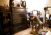 "Staff Sgt. Ashleigh Buch, an instructor with the 338th Combat Training Squadron, center, laces up her boots before she heads to Offutt Air Force Base on Friday, January 27, 2016 at her apartment in Omaha. Before the ban was lifted Buch was required to follow male dress and appearance standards at work which included strict hair regulations. Until her gender status was changed in the military she was forced to keep her hair short at work. ""It was that fact I had to get it cut short. I didn't have that option."" Growing her hair out was something that gave her confidence and courage and to lose that was very difficult for Buch. She recalls one haircut in that was especially traumatic because she'd been presenting as a woman outside of work for months. ""Every month I would basically want to cry at my stylist."" Now, Buch has the option to have long or short hair and has been growing it out since October. ""Appearance is a huge part of my identity. It's how I express my identity."""