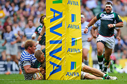 London Irish Flanker (#6) Kieran Low goes over the line to score a try during the first half of the match - Photo mandatory by-line: Rogan Thomson/JMP - Tel: Mobile: 07966 386802 07/09/2013 - SPORT - RUGBY UNION - Twickenham Stadium - London Irish v Saracens - Aviva Premiership - London Double Header.