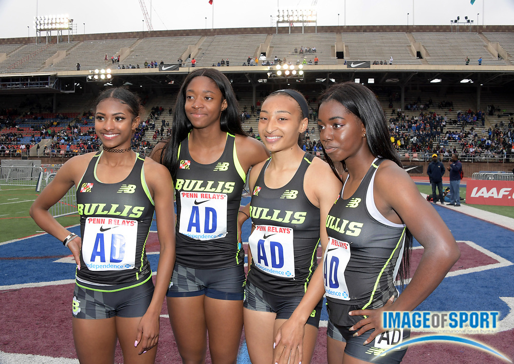 Apr 27, 2018; Philadelphia, PA, USA;  Members of the Bullis (Md.) girls 4 x 400m relay pose after placing third in the Championship of America in 3:41.51 as the top United States team during the 124th Penn Relays at Franklin Field. From left: Masai Russell, Sierra Leonard, Lauryn Harris and Ayanna Johnson.