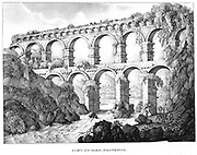Pont du Gard, Nimes, southern France. Roman aqueduct built c18 BC. No cement used. 19th century lithograph.