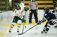 Vermont's Cassidy Campeau (18) battles for the puck with New Hampshire's Marie-Jo Pelletier (21) during the women's hockey game between the New Hampshire Wildcats and the Vermont Catamounts at Gutterson Field House on Friday night February 3, 2017 in Burlington. (BRIAN JENKINS/for the FREE PRESS)