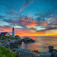 Portland Head Lighthouse at Fort Williams Park is an iconic New England lighthouse located on Cape Elizabeth in Maine. The lighthouse towers over the swirling Atlantic Ocean and seacoast, marking the entrance to Casco Bay and Portland. Upon arrival the gates to the park were already open leaving me enough time to scout for an appropriate composition that allows to incorporate the anticipated magical morning show in the sky and some of the dramatic seascape of coastal Maine.<br />