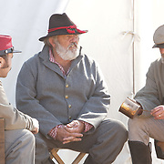 Steven Coley, left, Mike Reynolds, center, and Donnie Shannon, reenactors with the 13th Battalion N.C. Light Artiliary talk in their camp Sunday February 8, 2015 during the 10th Annual Civil War Living History Weekend at Cameron Art  Museum. The Weekend commemorated the Battle of Forks Road. (Jason A. Frizzelle)