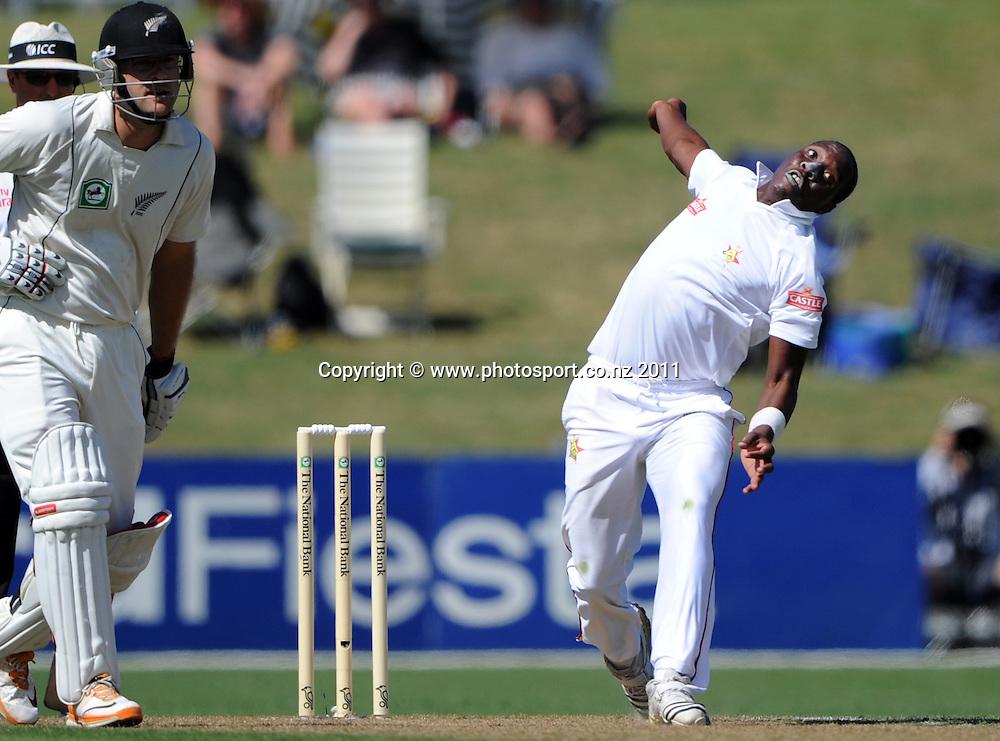 Shingirai Masakadza bowling on day 1 of the first cricket test, New Zealand v Zimbabwe at McLean Park. Thursday 26 January 2012. Napier, New Zealand. Photo: Andrew Cornaga/Photosport.co.nz