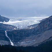Bow Glacier Falls drop dramatically from Bow Glacier before forming Bow Lake in Banff National Park, Canada. Simpson's Num-Ti-Jah Lodge is just a short hike away, nestled on the lake deep in the Canadian Rockies.
