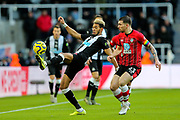 Joelinton (#9) of Newcastle United controls the ball under pressure from Pierre-Emile Hojbjerg (#23) of Southampton during the Premier League match between Newcastle United and Southampton at St. James's Park, Newcastle, England on 8 December 2019.