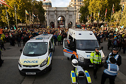 © Licensed to London News Pictures. 06/10/2019. London, UK. Police vans are parked in front of Marble Arch as Extinction Rebellion protesters gather to mark the beginning of two weeks of direct action in London. Photo credit: George Cracknell Wright/LNP