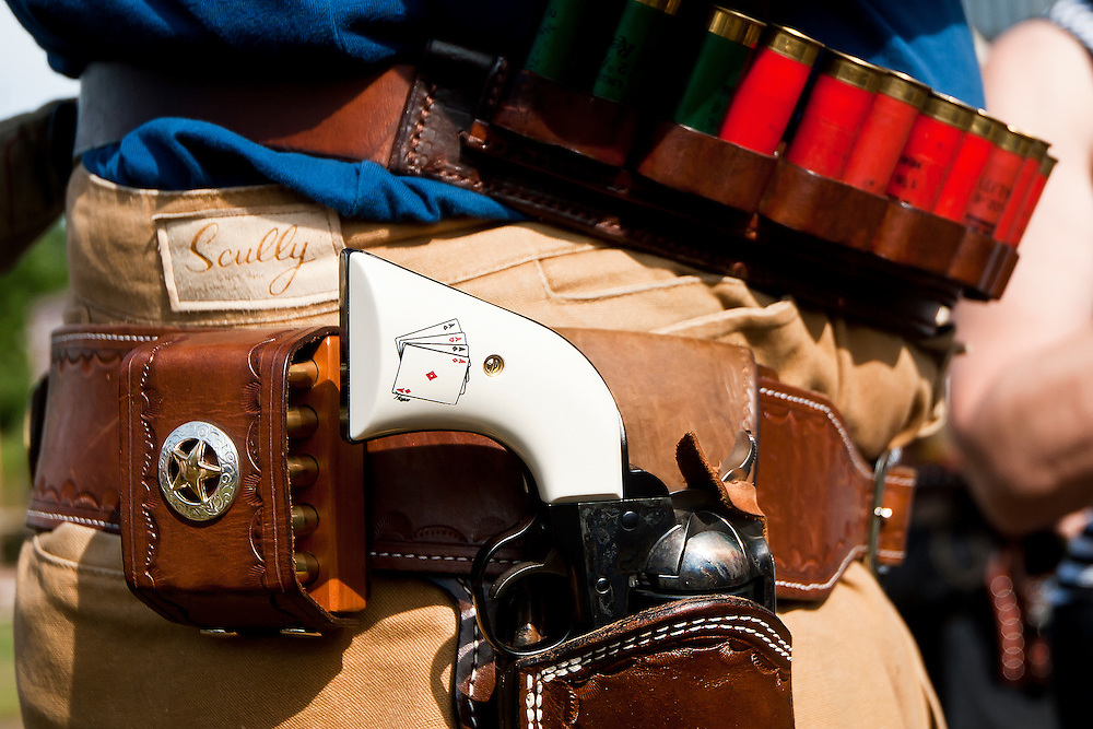 Lathan Goumas for the Midland Daily News..A gun of a shooter sits in a holder before a Cowboy Action Shooting competition at the Sucker Creek Saddle and Gun Club in Porter Township, Mich. on Saturday, July 21, 2012. Cowboy Action Shooting is a shooting sport where participants test their speed against others in situations based on the Old West. Participants dress up in western attire and shoot guns similar to those from the period.