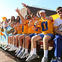 Tupelo High School Seniors cheer as they ride their float down Main Street in Tupelo during the Tupelo High School Homecoming Parade on Thursday afternoon. The parade ended in Fairpark with a pep rally.
