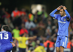 A dejected Ashley Cole holds his head in disbelief after Barcelona score during the UEFA Champions League Semi Final Second Leg match between Chelsea and Barcelona at Stamford Bridge on May 6, 2009 in London, England.
