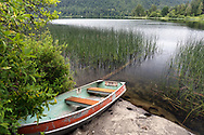 Rowboat on the shore of St. Mary Lake on Salt Spring Island, British Columbia, Canada