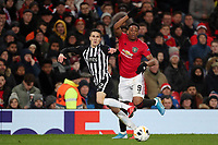 Football - 2019 / 2020 UEFA Europa League - Group L: Manchester United vs. FK Patrizan Belgrade<br /> <br /> <br /> Slobodan Urosevic of FK Partizan and Anthony Martial of Manchester United, at Old Trafford<br /> <br /> COLORSPORT/PAUL GREENWOOD