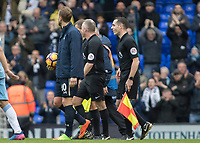 Football - 2016 / 2017 Premier League - Tottenham Hotspur vs. Stoke City<br /> <br /> Harry Kane of Tottenham collects the match ball from Referee John Moss and glances towards the North stand at White Hart Lane.<br /> <br /> COLORSPORT/DANIEL BEARHAM