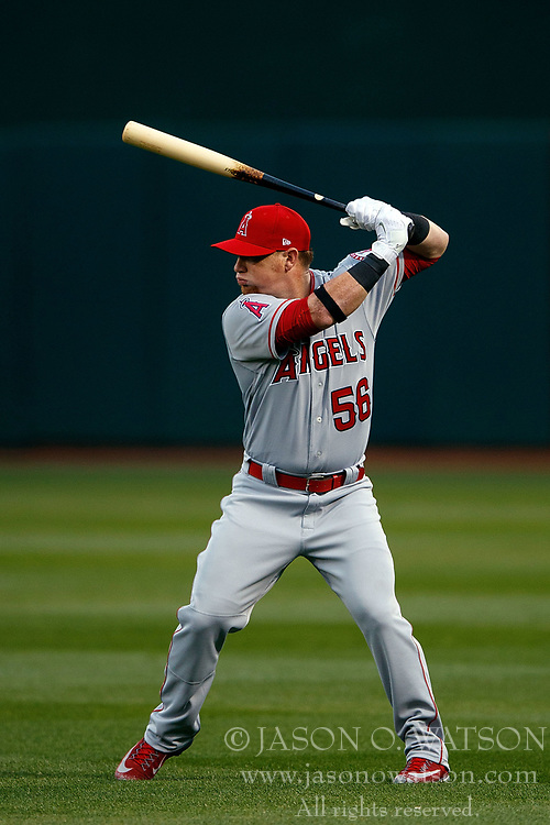 OAKLAND, CA - APRIL 04:  Kole Calhoun #56 of the Los Angeles Angels of Anaheim warms up before the game against the Oakland Athletics at the Oakland Coliseum on April 4, 2017 in Oakland, California. The Los Angeles Angels of Anaheim defeated the Oakland Athletics 7-6. (Photo by Jason O. Watson/Getty Images) *** Local Caption *** Kole Calhoun