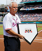 ATLANTA, GA - OCTOBER 2:  A member of the grounds crew holds a commemorative home plate to honor the last game at Turner Field before the game between the Detroit Tigers and the Atlanta Braves on Sunday, October 2, 2016 in Atlanta, Georgia. (Photo by Mike Zarrilli/MLB Photos via Getty Images) *** Local Caption ***