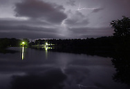 Middletown, New York - Lightning streaks across the sky and is reflected in the lake at Fancher-Davidge Park during a thunderstorm on the night of Aug. 1, 2011. ©Tom Bushey / The Image Works