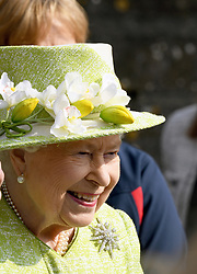 Queen Elizabeth II smiles during a visit to Manor Farm Stables in Ditcheat, Somerset on March 28, 2019.