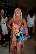 VANESSA FELTZ ( WITH 'REAL' SUNTAN ) , Beau Bronz  ( Tanning system ) launch, Avista Bar, Millennium Hotel, Grosvenor Sq. London. 17 August 2011.<br /> <br />  , -DO NOT ARCHIVE-© Copyright Photograph by Dafydd Jones. 248 Clapham Rd. London SW9 0PZ. Tel 0207 820 0771. www.dafjones.com.