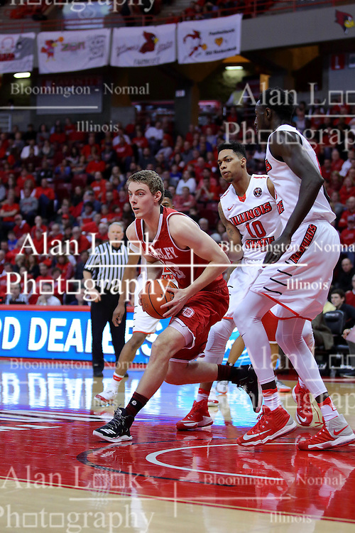 """11 February 2017:  Luuk van Bree rounds Phil Fayne(10) and Daouda """"David"""" Ndiaye (4) during a College MVC (Missouri Valley conference) mens basketball game between the Bradley Braves and Illinois State Redbirds in  Redbird Arena, Normal IL"""