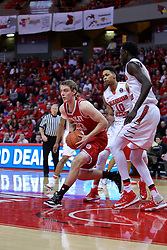 "11 February 2017:  Luuk van Bree rounds Phil Fayne(10) and Daouda ""David"" Ndiaye (4) during a College MVC (Missouri Valley conference) mens basketball game between the Bradley Braves and Illinois State Redbirds in  Redbird Arena, Normal IL"