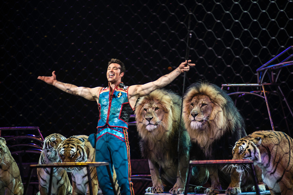 BALTIMORE, MD -- 4/21/17 -- Big Cat Trainer Alexander Lacey comes from a family of animal trainers. Ringling Bros, the self-proclaimed Greatest Show on Earth, is in the final leg of a 146 year run. The final performances will be held in May. Out of This World, one of two circus units, recently had performances in Baltimore, led by Jonathan Lee Iverson, the first African-American ringmaster in the show's history…by André Chung #_AC27697