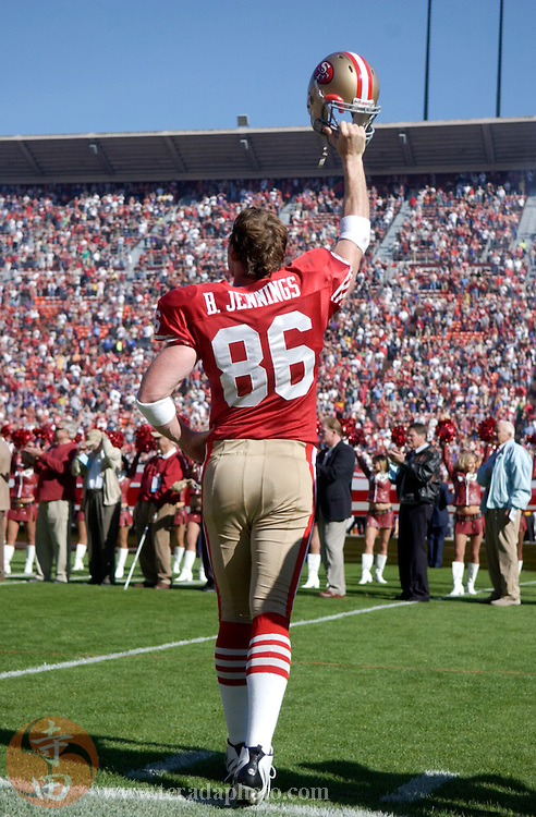 Nov 5, 2006 San Francisco, CA, USA: San Francisco 49ers tight end Brian Jennings (86) raises his helmet during the national anthem before the game against the Minnesota Vikings at Monster Park. The 49ers defeated the Vikings 9-3.