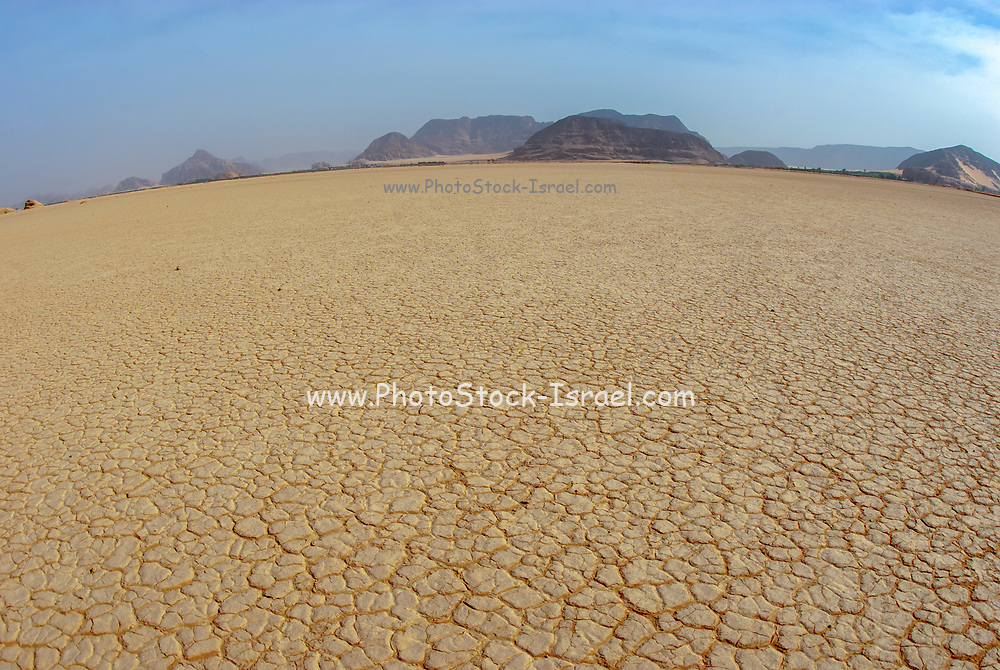 Desert Landscape. Cracked dry earth in an arid area. Photographed in Wadi Rum, Jordan in April