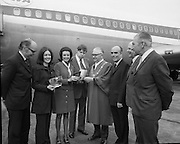 First Direct T.W.A.Flight To Dublin.    (G68)..1974..02.05.1974..05.002.1974..2nd May 1974..Today saw the first direct trans-Atlantic flight direct to Dublin airport from the U.S.A. T.W.A. (Trans World Airways) were the flight operators and the aircraft used was a Boeing 707, registry number N799TW. .Pictured at the Boeing 707 aircraft were .Mr R A Sorenson,Counsellor,U.S.Embassy, Miss Anne O'Dwyer (who presented a silver bowl to Mr Fred Mullen), Mr George Burns,VP,Public Relations,T.W.A., .Mr Fred Mullen,Chairman,Dublin City Commissioners, .Mr Liam Boyd, Manager in Ireland,T.W.A.,.Mr Eamonn Ceannt,Director General, Bord Failte and .Mr R.C.O'Connor, Chief Executive, Aer Rianta.