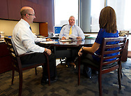 James Klein (from left), Senior Vice President, Larry Helling, President of Cedar Rapids Bank & Trust, and Wendy Nielsen, Assistant Vice President of Medial Relations, talk in Helling's office in Cedar Rapids, Iowa on Monday, August 20, 2012. .