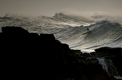 December 13, 2017 - Waimea Bay, HI, USA - WAIMEA BAY, HI - DECEMBER 13, 2017 - Professional surfer John John Florence of Hawaii drops in on a large wave at Waimea Bay. The big wave surfing spot only breaks in the winter when storms send large north swells toward the North Shore of Oahu. (Credit Image: © Erich Schlegel via ZUMA Wire)