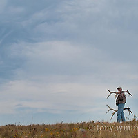 man with shed elk antlers