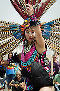 Aztec Meshika Dancers give a special dance presentation at The University of New Mexico as part of the 31st annual Gathering of Nations Powwow, Albuquerque, New Mexico.