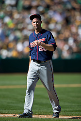 OAKLAND, CA - SEPTEMBER 22: Josh Roenicke #20 of the Minnesota Twins returns to the dugout after being relieved against the Oakland Athletics during the sixth inning at O.co Coliseum on September 22, 2013 in Oakland, California. The Oakland Athletics defeated the Minnesota Twins 11-7 as they clinched the American League West Division. (Photo by Jason O. Watson/Getty Images) *** Local Caption *** Josh Roenicke