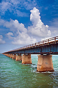 The Old Seven Mile Bridge was originally an overseas railroad line constructed in the early 1900's by Henry Flagler to connect Miami to Key West.  The railroad was destroyed by a hurricane in 1935 and today the original bridge is used for walking and biking.  It is listed on the National Register of Historic Places.