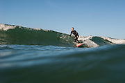 Dave Shively paddlesurfing in Southern California.