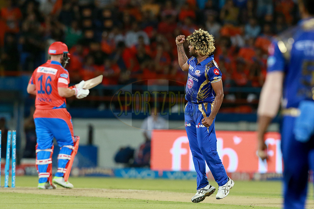 Lasith Malinga of MI celebrates after takes a wicket of Aaron Finch of GL during match 35 of the Vivo 2017 Indian Premier League between the Gujarat Lions and the Mumbai Indians  held at the Saurashtra Cricket Association Stadium in Rajkot, India on the 29th April 2017<br /> <br /> Photo by Rahul Gulati - Sportzpics - IPL